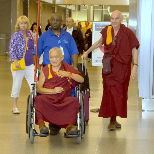 Lama Zopa Rinpoche arriving in North Carolina with Ven. Roger Kunsang, April 30, 2014. Photo copyright David Stravel.