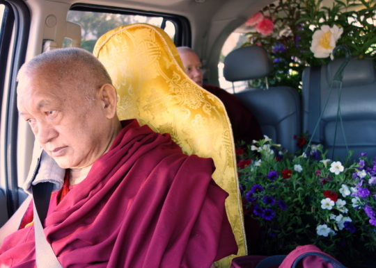 Lama Zopa Rinpoche returning to Kachoe Dechen Ling after shopping for flower offerings, California, US. May 2014. Photo by Ven. Roger Kunsang.