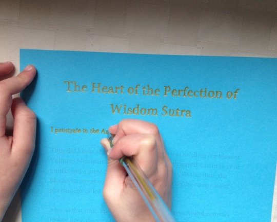 Dechen Bloom hand-tracing the Heart Sutra for Lama Zopa Rinpoche's long life, April 2014