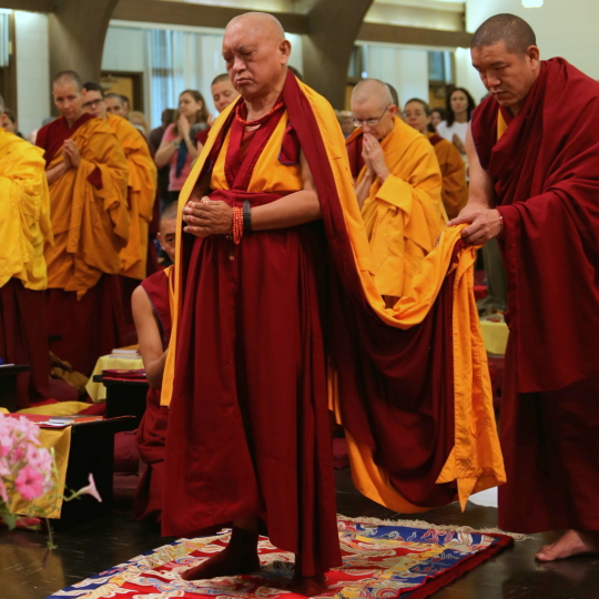 Lama Zopa Rinpoche doing full length prostrations at Light of the Path, Black Mountain, North Carolina, US, May 2014. Photo by Ven. Roger Kunsang.
