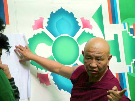 Jhado Rinpoche talks with head painter Pema Dawa about progress on the mandala for Tushita's gompa, May 2014. Photo courtesy of Tushita Meditation Centre.