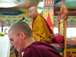 Jhado Rinpoche teaches with Geshe Kelsang Wangmo serving as translator, May 2014. Photo courtesy of Tushita Meditation Centre.