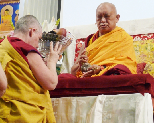Lama Zopa Rinpoche being offered tsog by Ven. Chantal, director of International Mahayana Institute, during Light of the Path Retreat, May 2014. Photo by Kalleen Mortensen.
