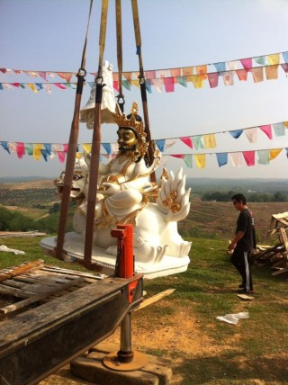 Namthose is gently set into his new home at Rinchen Jangsem Ling, Triang, Malaysia, April 2014. Photo courtesy of Rinchen Jangsem Ling.