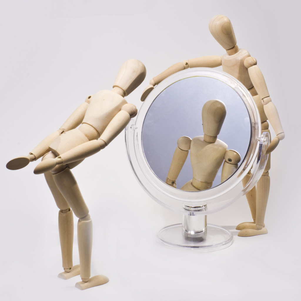 holding a mirror. image: dreamstime.com holding a mirror s