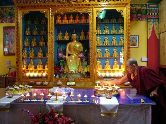 "Saka Dawa butterlamp offering with ""Old Lama Gyupa,"" Tushita Meditation Centre, Dharamsala, India, June 13, 2014. Photo courtesy of Tushita Meditation Centre."