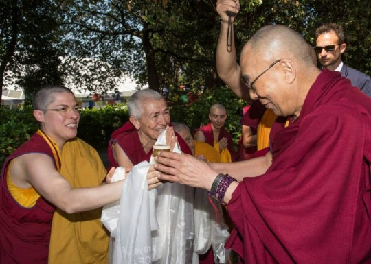 His Holiness being greeted by Sangha at Istituto Lama Tzong Khapa, Pomaia, Italy, June 2014. Photo courtesy of Dalai Lama Italia on Facebook.
