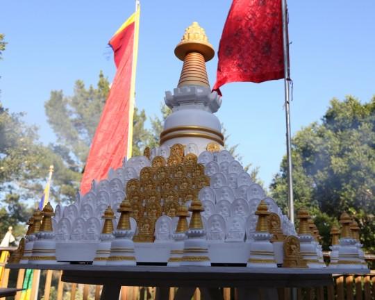 A stupa surrounded by tsa-tsas at Kachoe Dechen Ling, California, June 2014. Photo by Ven. Thubten Kunsang.
