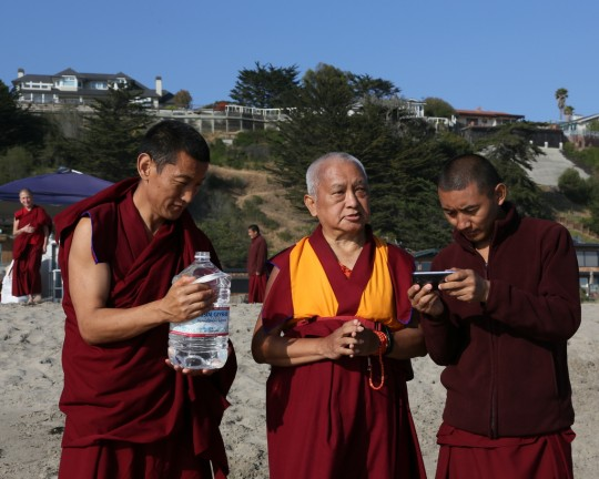 Lama Zopa Rinpoche with Vens. Tsering and Sangpo blessing all the beings in the ocean, California, US, May 2014. Photo by Ven. Thubten Kunsang.