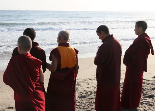 Lama Zopa Rinpoche with Sangha on the beach in California, May 2014. Photo by Ven. Thubten Kunsang.