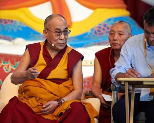 His Holiness the Dalai Lama teaching at Istituto Lama Tzong Khapa with Geshe Tashi Tsering, resident geshe at Jamyang Buddhist Centre, and Fabrizio Palliotti, providing interpretation, Pomaia, Italy, June 13, 2014. Photo by Olivier Adam.