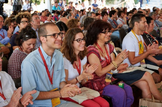 Audience members at His Holiness the Dalai Lama's talk at Istituto Lama Tzong Khapa, Italy, June 13, 2014. Photo by Olivier Adam.