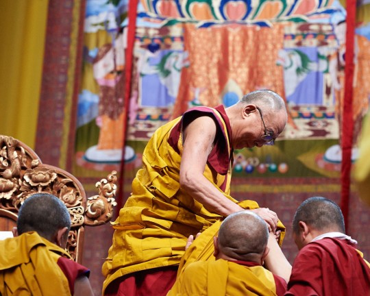His Holiness the Dalai Lama descending from throne, Livorno, Italy, June 15, 2014. Photo by Olivier Adam.