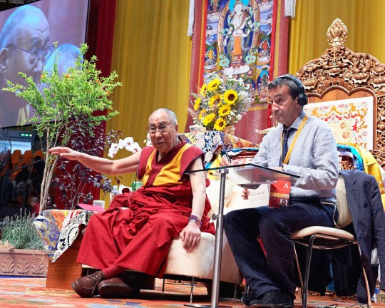 His Holiness the Dalai Lama during afternoon teaching with Fabrizio Palliotti interpreting, Livorno, Italy, June 15, 2014. Photo by Olivier Adam.