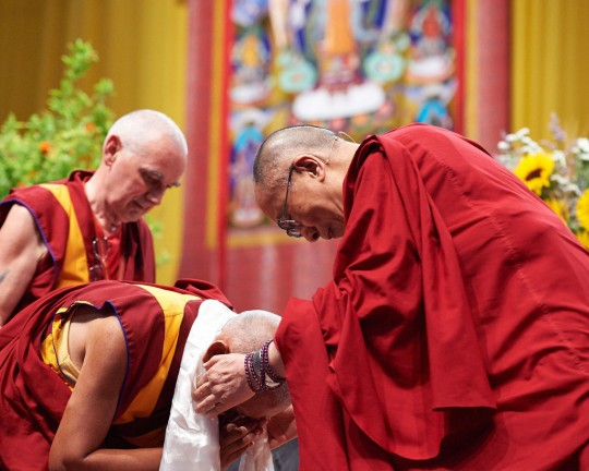 Lama Zopa Rinpoche offering His Holiness the Dalai Lama a khata, Livorno, Italy, June 15, 2014. Photo by Olivier Adam.