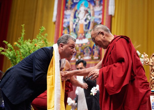 His Holiness the Dalai Lama offering a khata to Filippo Scianna, director of Istituto Lama Tzong Khapa, Livorno, Italy, June 15. Photo by Olivier Adam.