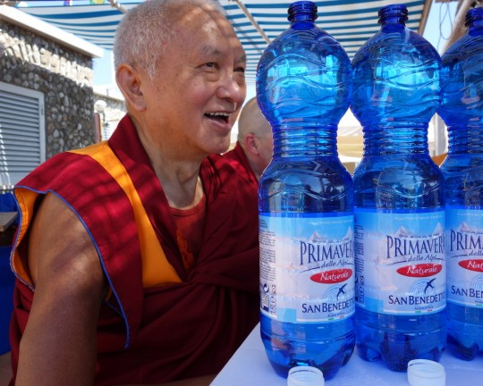 Lama Zopa Rinpoche blessing water to be offered to pretas at the beach, Italy, June 2014. Photo by Ven. Roger Kunsang.