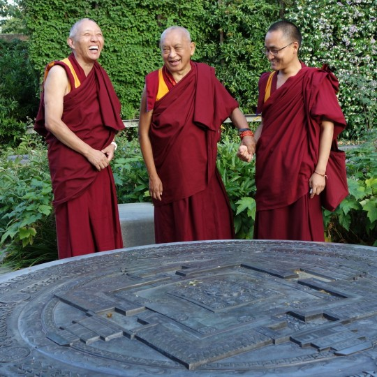Lama Zopa Rinpoche with Jamyang Buddhist Centre resident teacher Geshe Tashi (left) and Ven. Sherab, Rinpoche's attendant, enjoying the Kalacharka mandala in the Peace Garden near Jamyang Buddhist Centre, London, UK, July 2014. Photo by Ven. Roger Kunsang.