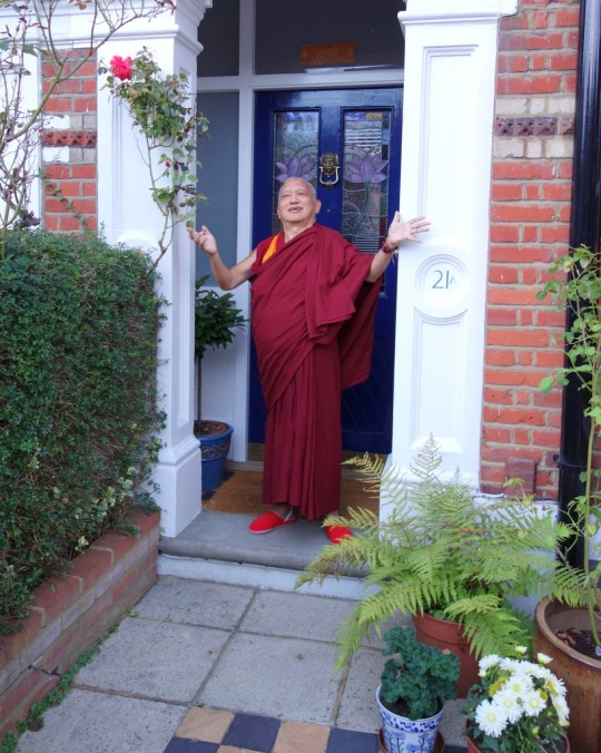 """Lama Zopa Rinpoche leaving the house where he was staying in London, next day was the flight London to the USA. ... Rinpoche is gesturing how much he enjoyed staying there and thanking the kind family who offered their house,"" share Ven. Roger Kunsang, London, UK, July 2014. Photo by Ven. Roger Kunsang."