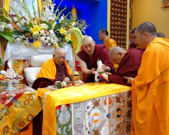 Lama Zopa Rinpoche offering body, speech and mind mandala to Geshe Sopa Rinpoche during the long life puja for Geshe Sopa, Deer Park Buddhist Center, Wisconsin, US, July 20, 2014. Photo by Ven. Roger Kunsang.