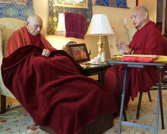 Lama Zopa Rinpoche doing prayers with Geshe Sopa Rinopche, Deer Park Buddhist Center, Wisconsin, US, July 20, 2014. Photo by Ven. Roger Kunsang.