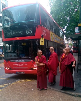 Lama Zopa Rinpoche, with Vens. Sangpo and Kunsang, just after arriving in London, UK, July 2014. Photo by Ven. Roger Kunsang.