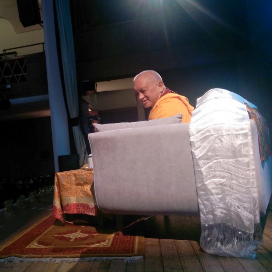 Lama Zopa Rinpoche during a public teaching in London, UK, July 2014. Photo by Ven. Roger Kunsang.