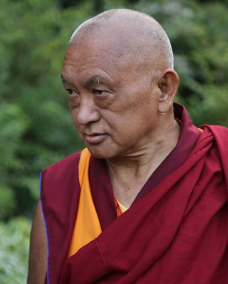 Lama Zopa Rinpche at a garden in Leeds, UK, July 2014. Photo by Ven. Thubten Kunsang.