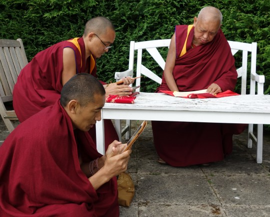 Lama Zopa Rinpoche with Vens. Sangpo and Sherab doing prayers for the future retreat center Land of Joy, UK, July 2014. Photo by Ven. Roger Kunsang.
