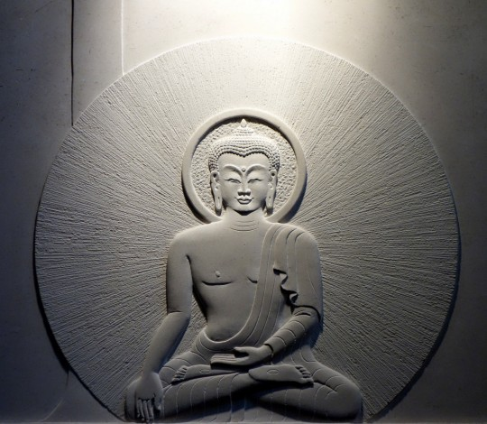 Buddha in relief, Jamyang Buddhist Centre, London, UK, July 2014. Photo by Ven. Roger Kunsang.