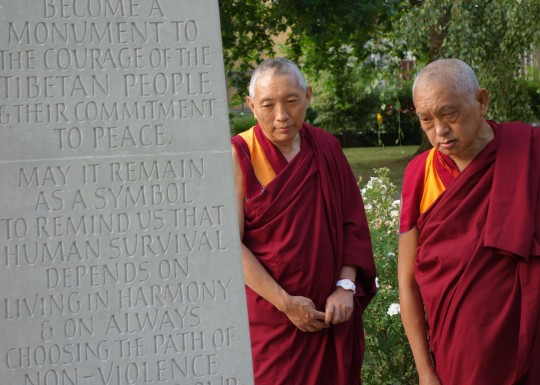 Lama Zopa Rinpoche with Geshe Tashi, resident geshe at Jamyang Buddhist Centre, visiting the the Tibetan Peace Garden next to the Imperial War Museum in London, UK, July 2014. Photo by Ven. Roger Kunsang.