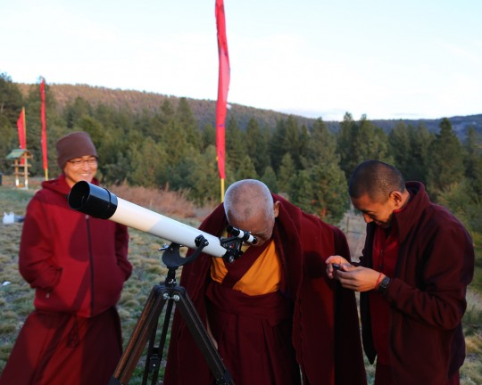 Lama Zopa Rinpoche looking through Lama Yeshe's old telescope, Buddha Amitabha Pure Land, Washington, US, April 2014. Photo Ven. Roger Kunsang.