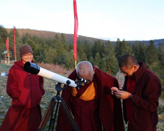 Lama Zopa Rinpoche looking through Lama Yeshe's old telescope, Buddha Amitabha Pure Land, Washington, US, April 2014. Photo Ven. Roger Kunsang.