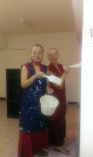 Vens. Drolkar and Gyaltsen painting the wall during minor renovations at Shakyamuni Center, Taichung City, Taiwan, 2014. Photo courtesy of FPMT Taiwan.