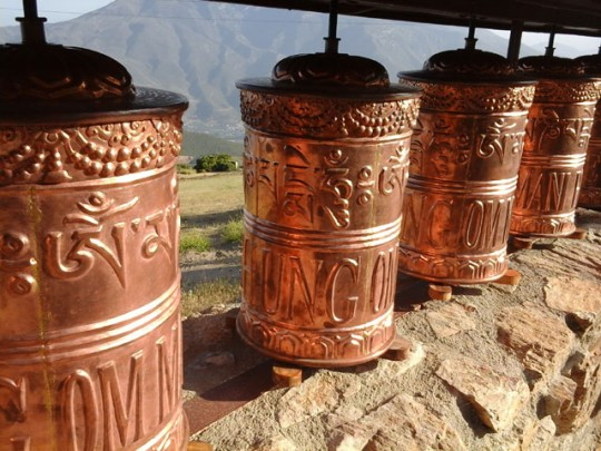 Embossed detail on O.Sel.Ling prayer wheels, 2014. Photo by Ruud van Arhem.