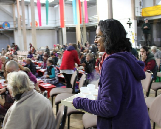 Mallika Krishnamurthy distributing tea during the long life puja, Great Stupa of Universal Compassion, Australia, Septebmer 19, 2014. Photo by Laura Miller.