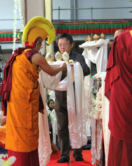 Steve Lin from FPMT Taiwan offering during long life puja, Great Stupa of Universal Compassion, Australia, September 19, 2014. Photo by Laura Miller.
