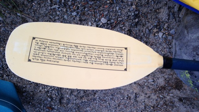 Kayak paddle with Namgyälma mantra, Waldo Lake, Oregon, US, August 2014. Photo courtesy of Mandala Publications.