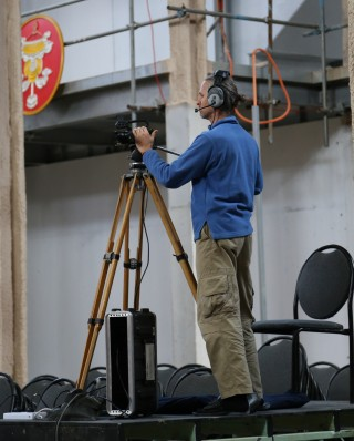 Harald operating a camera during a teaching by Lama Zopa Rinpoche, Great Stupa of Universal Compassion, Australia, September 2014. Photo by Ven. Thubten Kunsang.