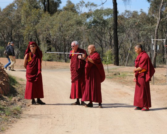 Lama Zopa Rinpoche and Khen Rinpoche Geshe Chonyi with Vens. Roger and Sangpo outside of the Great Stupa of Universal Compassion, Australia, September 2014. Photo by Ven. Thubten Kunsang.