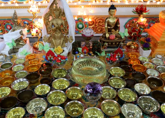 Offerings to the Guru Rinpoche statue in the Great Stupa of Universal Compassion, Australia, September 17, 2014. Photo by Ven. Thubten Kunsang