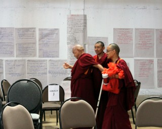 Lama Zopa Rinpoche arriving at the CPMT 2014 meeting for afternoon session on Day 2, Great Stupa of Universal Compassion, Australia, September 14, 2014. Photo by Laura Miller.