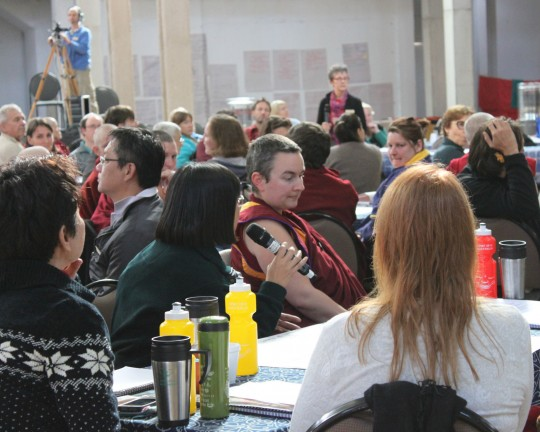 Reporting back after small group discussion on FPMT Education Programs, CPMT 2014, Great Stupa of Universal Compassion, Australia, September 14, 2014. Photo by Laura Miller.