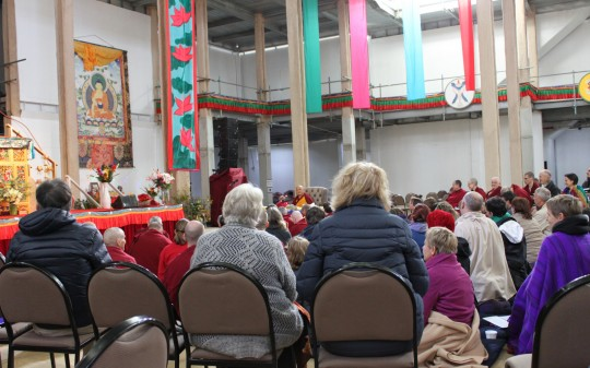 CPMT 2014 participant listening as Lama Zopa Rinpoche offers the morning meditation.