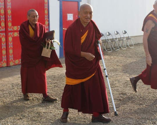 Lama Zopa Rinpoche leaving the Great Stupa of Universal Compassion after the morning motivation, Victoria, Australia, September 16, 2014. Photo by Laura Miller.