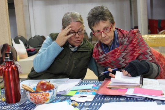 Claire Isitt and Sandra Stubbings going over the agenda on Day 6 of CPMT 2014, Great Stupa of Universal Compassion, Australia, September 18, 2014. Photo by Laura Miller.
