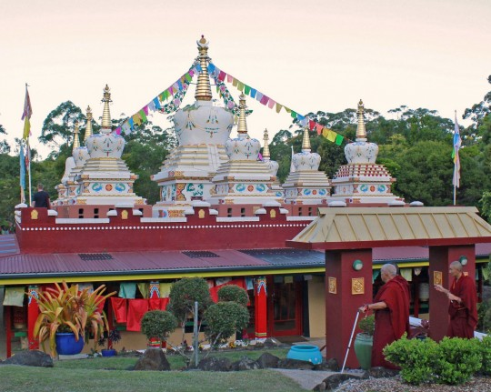 Lama Zopa Rinpoche and the eight stupas that are part of the Garden of Enlightenment at Chenrezig Institute, Queensland, Australia, September 2014. Photo by Ven. Lobsang Sherab.