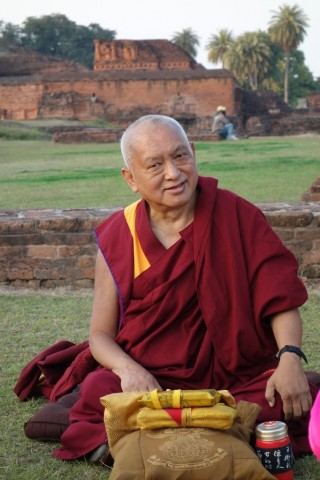 "Lama Zopa Rinpoche giving the oral transmission for Lama Tsongkhapa's ""In Praise of Dependent Arising"" at Nalanda, Bihar, India, February 2014. Photo by Ven. Roger Kunsang."